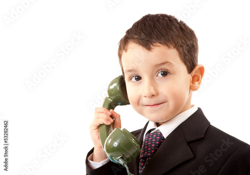 Small Boy Talking On The Telephone