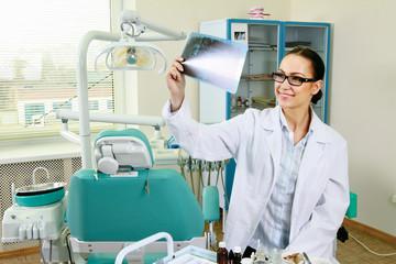 A dentist holding an x-ray