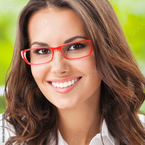Young happy smiling businesswoman at office