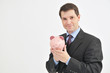Businessman Holding Pink Piggy Bank