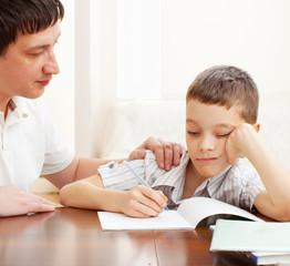 Father helping son do homework