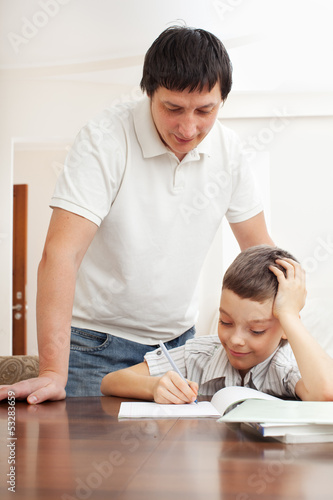 Father helping son do homework