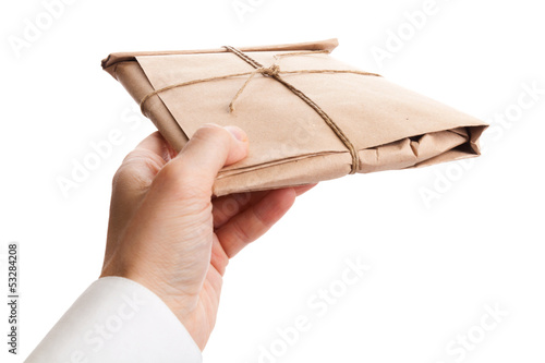 Male hand delivers full envelope tied with a rope