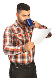 Man drink coffee and holding paper