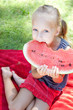Funny child with watermelon in the park