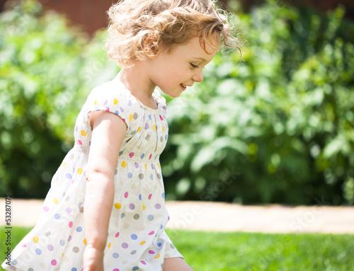 Adorable little girl taken closeup outdoors in summer