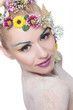 beauty woman with flowers in hair looks at you
