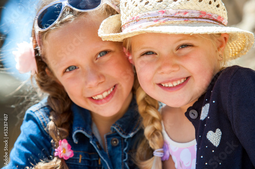 Two girls smiling together.