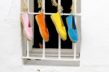 Four shoes hanging
