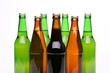Closed bottles of beer isolated on a white background