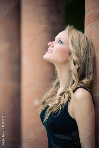 Beautiful girl outdoors intimate portrait.