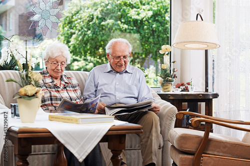 Senior couple reading the newspaper