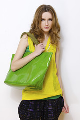 young woman in shirt and bag posing at studio