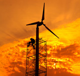 Wind turbine with sunset background