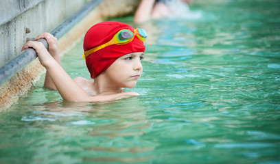 Kid in thermal swimming pool.