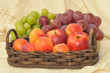 Fresh fruits in artisan basket closeup image