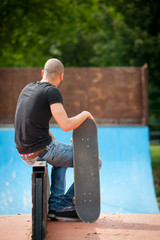 Skateboarder portrait from behind.