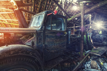 abandoned truck in barn
