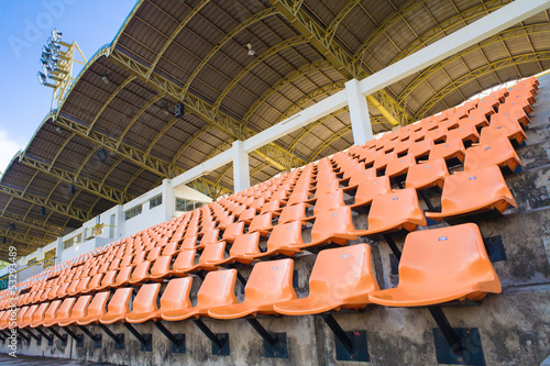 Stadium Orange Chair with roof and blue sky