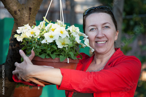 Smiling mature woman and flowers