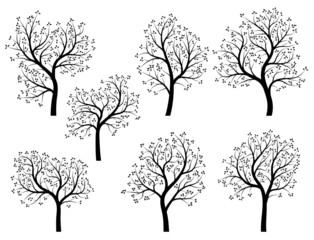 Abstract silhouettes of spring trees with leaves.