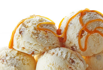 ice cream balls decorated with caramel sauce