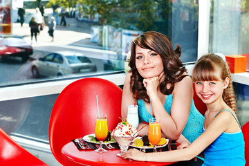 Mother and daughter in restaurant.