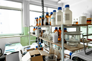 Photo of an old laboratory with a lot of bottles