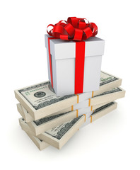 Gift box on a stack of dollars.