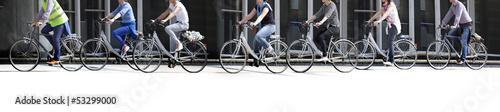Leinwandbild Motiv A large group of cyclists. Rent bikes.