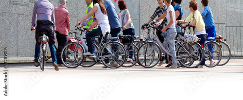 A large group of cyclists. Rent bikes.