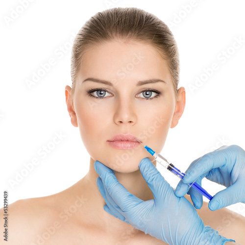 Portrait of woman getting botox injection, isolated