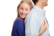 Young woman embracing her boyfriend