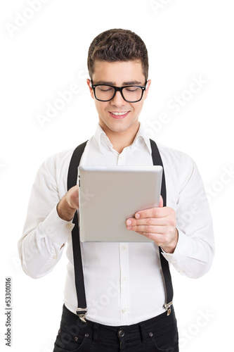 Handsome businessman with tablet computer smiling