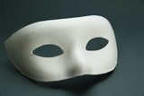 White mask, on grey background