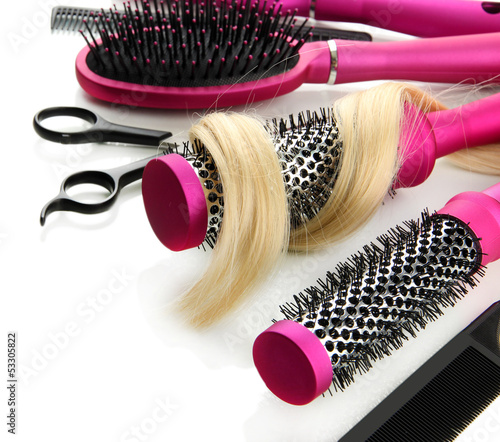 Comb brushes, hair and cutting shears, isolated on white