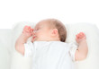 Newborn infant baby girl sleeping on her back