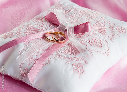 Wedding gold rings on a pillow