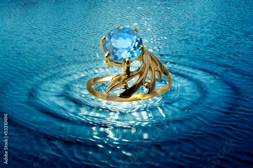 Jewelry ring in water waves