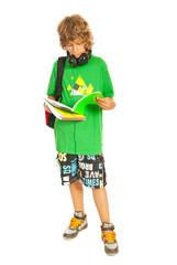 Cool teen schoolboy reading