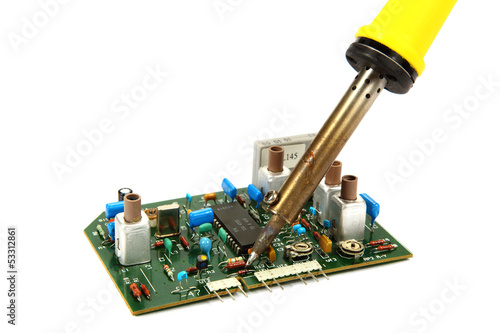 Board and a soldering iron isolated on a white background.