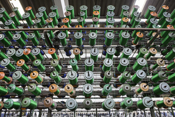 Large group of bobbin thread cones on machine