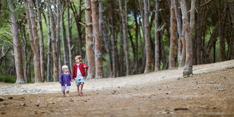 Two sisters having a walk in the woods