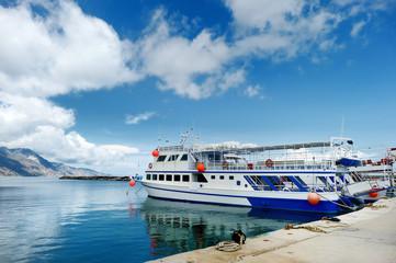 Small ferryboat docked in greek town