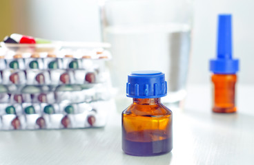 bottle, tablets and capsules