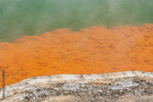 orange deposits on ledges in Champagne pool