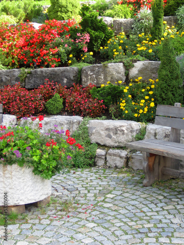fototapete stone wall bench and plants on colorful. Black Bedroom Furniture Sets. Home Design Ideas