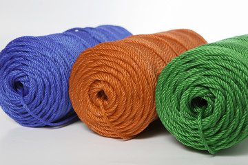 Rolls of green, blue and red polyester rope - close up
