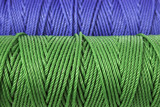 Rolls of green and blue polyester rope - close up poster
