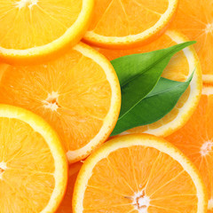 Stack of orange fruit slices background.